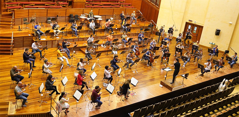 Orchestras emerge from lockdown with 'distanced repertoire'